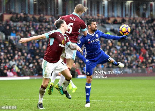 Diego Costa of Chelsea tangles with Ben Mee of Burnley during the Premier League match between Burnley and Chelsea at Turf Moor on February 12 2017...