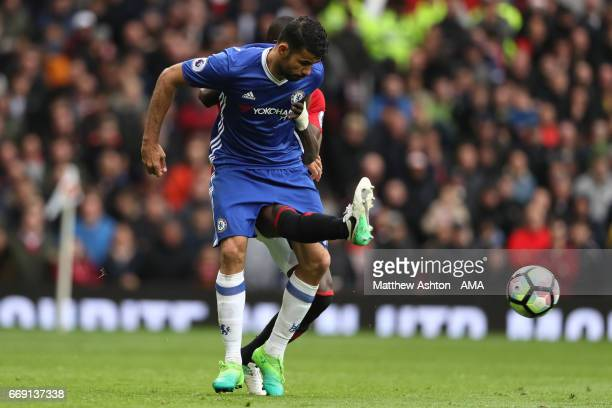 Diego Costa of Chelsea tangles with Eric Bailly of Manchester United during the Premier League match between Manchester United and Chelsea at Old...