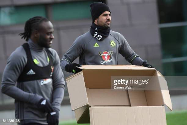 Diego Costa of Chelsea with a cardboard box before a training session at Chelsea Training Ground on February 23 2017 in Cobham England
