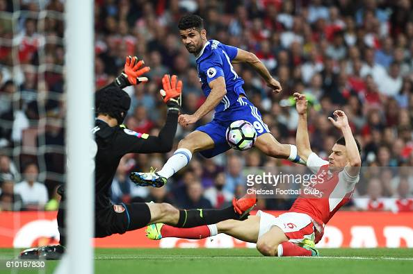 Diego Costa of Chelsea yakes a shot on goal under pre4ssure from Laurent Koscielny of Arsenal during the Premier League match between Arsenal and...