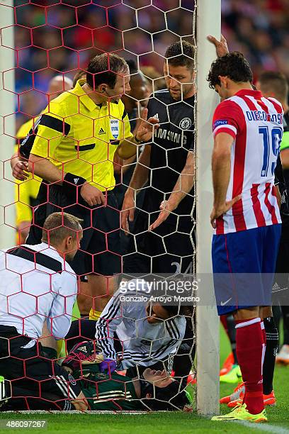 Diego Costa of Club Atletico de Madrid and Gary Cahill of Chelsea look on as Petr Cech of Chelsea receives treatment during the UEFA Champions League...