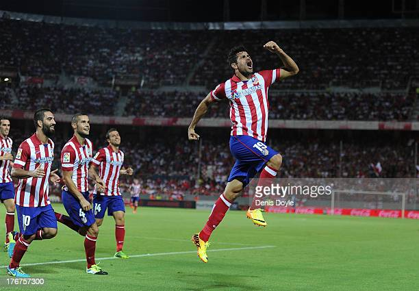Diego Costa of Club Atletico de Madrid celebrates after scoring Atletico's opening goal during the La Liga match between Sevilla FC and Club Atletico...