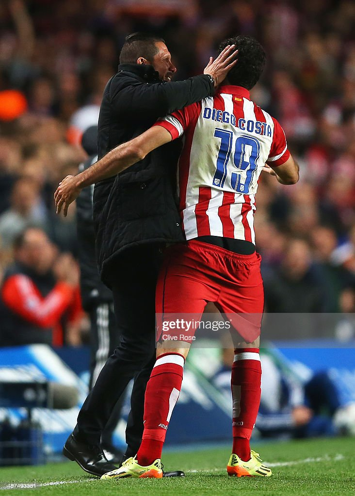 Diego Costa (R) of Club Atletico de Madrid celebrates his goal with Diego Simeone, coach of Club Atletico de Madrid during the UEFA Champions League semi-final second leg match between Chelsea and Club Atletico de Madrid at Stamford Bridge on April 30, 2014 in London, England.