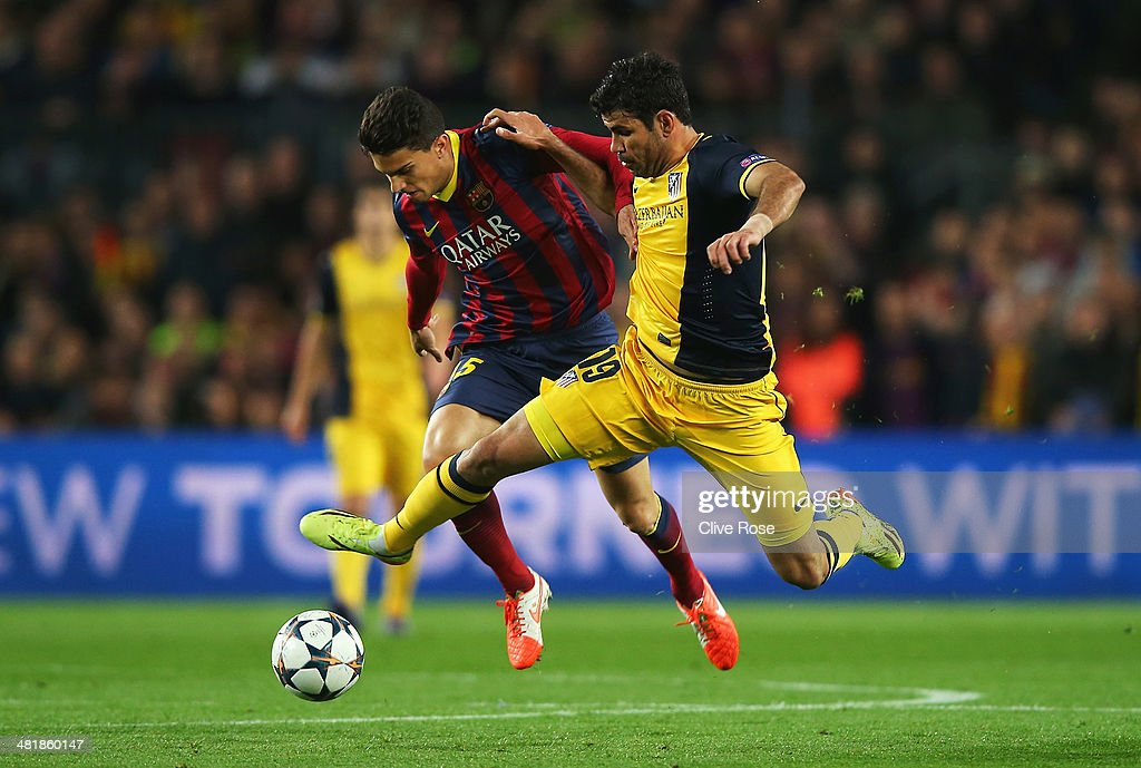 Diego Costa of Club Atletico de Madrid challenges Marc Bartra of Barcelona during the UEFA Champions League Quarter Final first leg match between FC Barcelona and Club Atletico de Madrid at Camp Nou on April 1, 2014 in Barcelona, Spain.