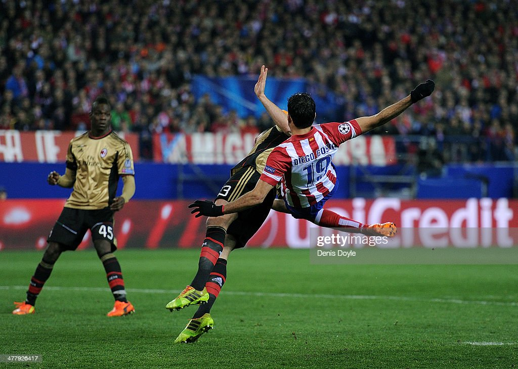 Diego Costa (R) of Club Atletico de Madrid clashes with <a gi-track='captionPersonalityLinkClicked' href=/galleries/search?phrase=Adil+Rami&family=editorial&specificpeople=4305019 ng-click='$event.stopPropagation()'>Adil Rami</a> of AC Milan during the UEFA Champions League Round of 16, 2nd leg match between Club Atletico de Madrid v AC Milan at Vicente Calderon Stadium on March 11, 2014 in Madrid, Spain.