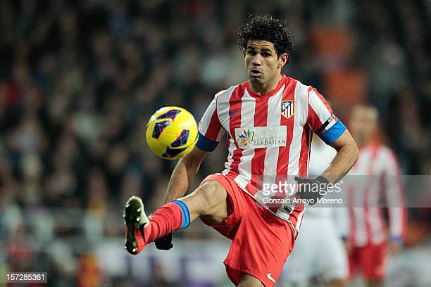 Diego Costa of Club Atletico de Madrid controls the ball during the La Liga match between Real Madrid CF and Club Atletico de Madrid at Estadio...