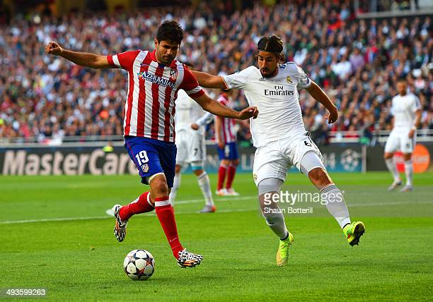 Diego Costa of Club Atletico de Madrid is marshalled by Sami Khedira of Real Madrid during the UEFA Champions League Final between Real Madrid and...