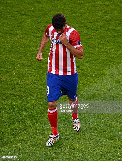 Diego Costa of Club Atletico de Madrid leaves the field injured during the UEFA Champions League Final between Real Madrid and Atletico de Madrid at...