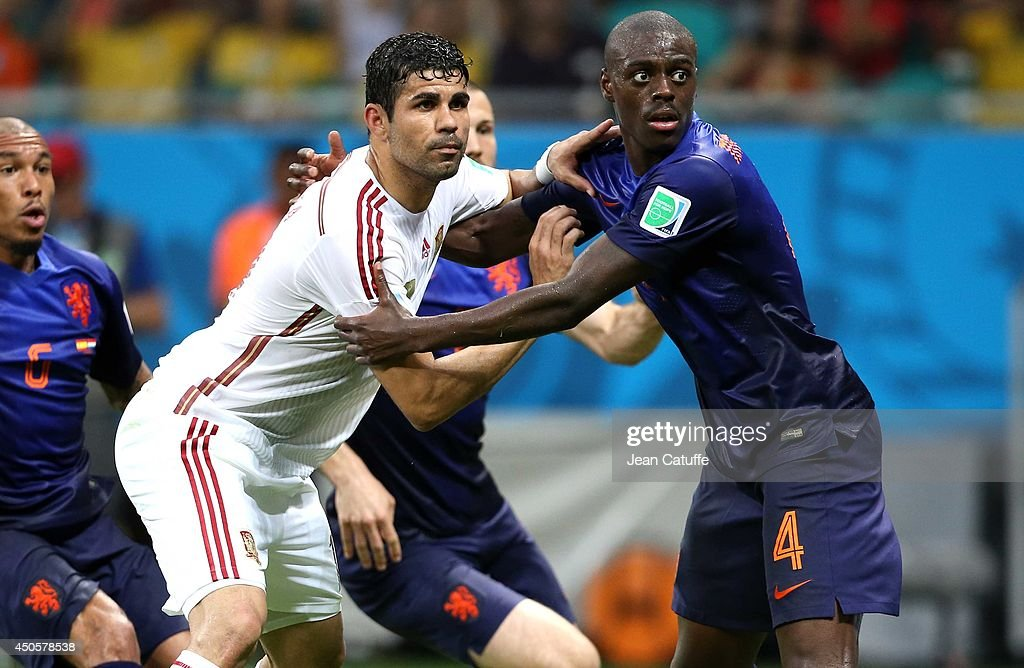 Diego Costa of Spain and <a gi-track='captionPersonalityLinkClicked' href=/galleries/search?phrase=Bruno+Martins+Indi&family=editorial&specificpeople=7155940 ng-click='$event.stopPropagation()'>Bruno Martins Indi</a> of the Netherlands in action during the 2014 FIFA World Cup Brazil Group B match between Spain and Netherlands at Arena Fonte Nova on June 13, 2014 in Salvador, Brazil.