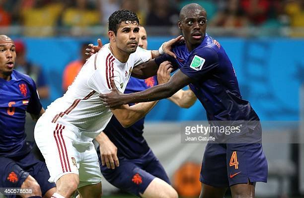 Diego Costa of Spain and Bruno Martins Indi of the Netherlands in action during the 2014 FIFA World Cup Brazil Group B match between Spain and...