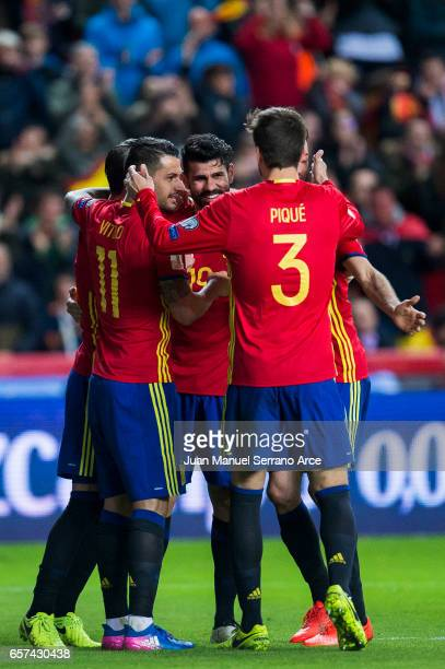 Diego Costa of Spain celebrates with his teammates Sergio Ramos and Victor Machin Perez 'Vitolo' of Spain after scoring his team's third goal during...