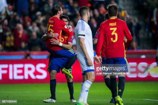 Diego Costa of Spain celebrates with his teammates Sergio Ramos of Spain after scoring his team's third goal during the FIFA 2018 World Cup Qualifier...