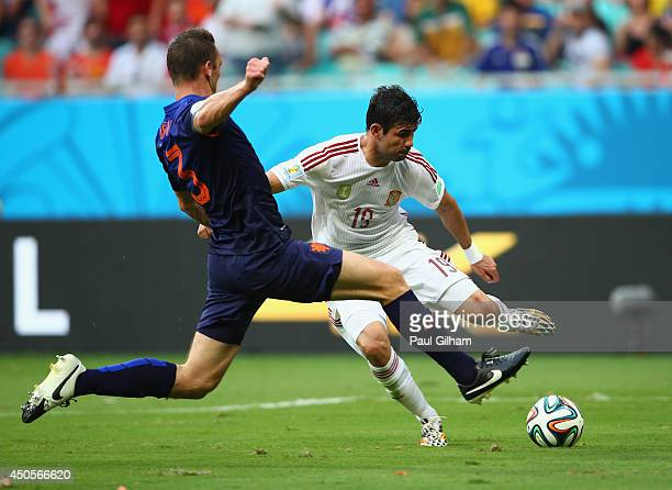 Diego Costa of Spain is fouled by Stefan de Vrij of the Netherlands and awarded a penalty in the first half during the 2014 FIFA World Cup Brazil...
