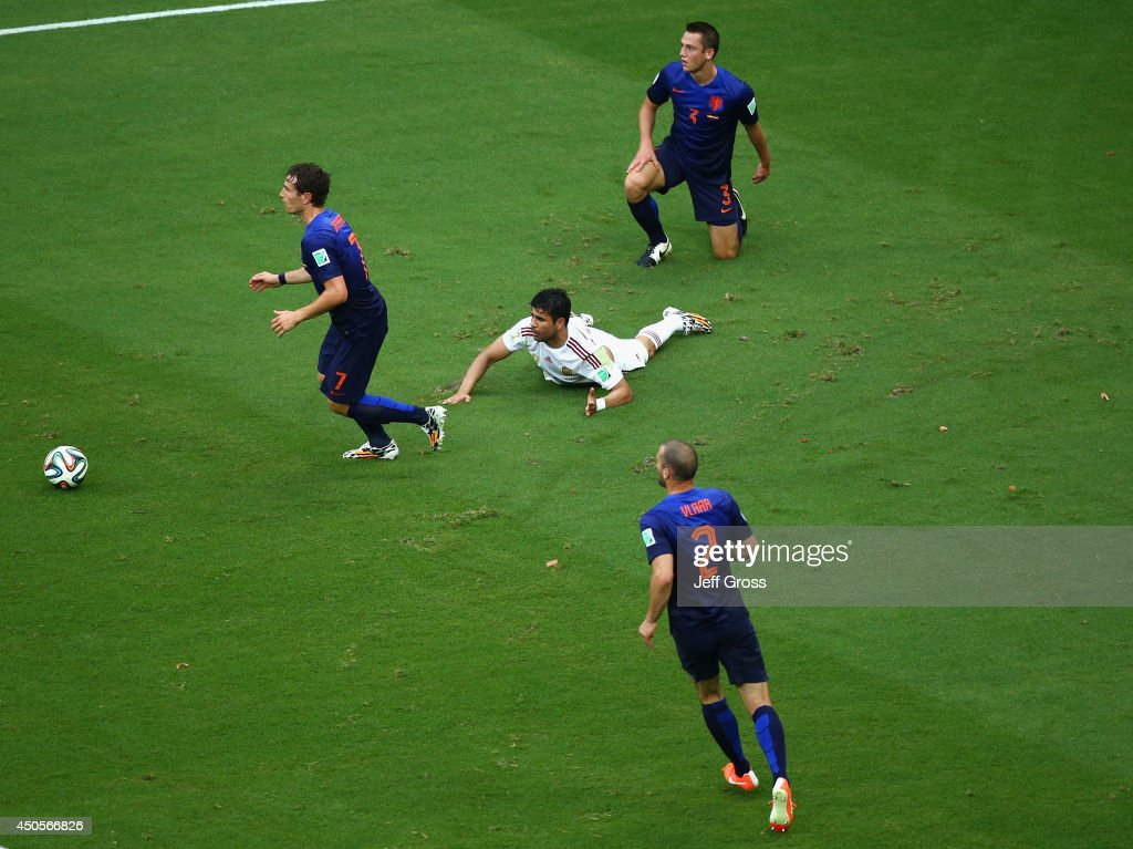 Diego Costa of Spain lies on the field after being fould by Gerard Pique of Spain and awarded a penalty kick in the first half during the 2014 FIFA World Cup Brazil Group B match between Spain and Netherlands at Arena Fonte Nova on June 13, 2014 in Salvador, Brazil.