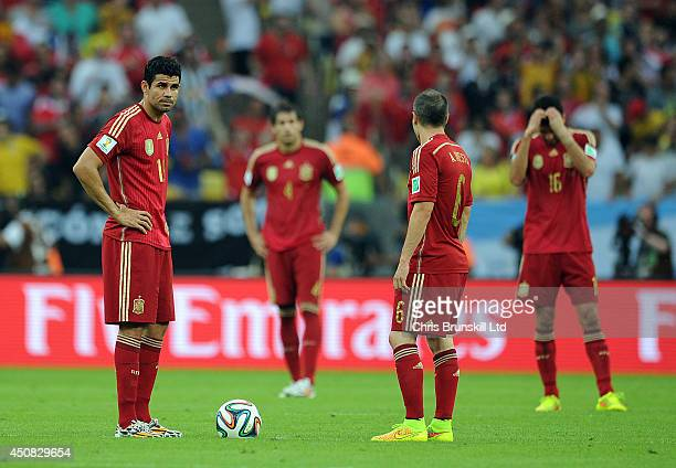 Diego Costa of Spain looks dejected as he waits to restart the match following Chile's first goal during the 2014 FIFA World Cup Brazil Group B match...