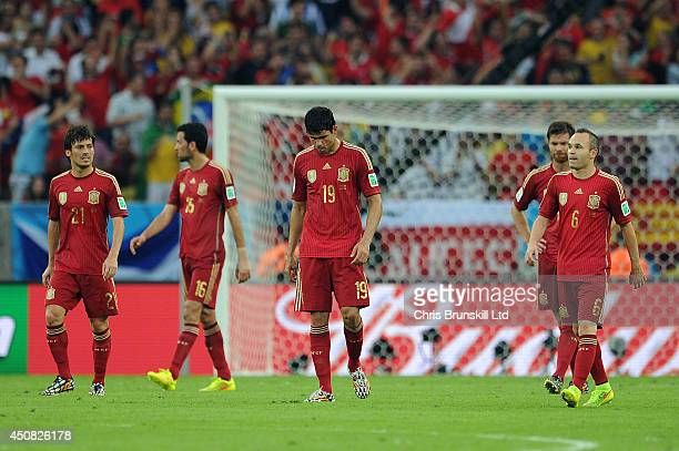 Diego Costa of Spain looks dejected following Chile's second goal during the 2014 FIFA World Cup Brazil Group B match between Spain and Chile at...