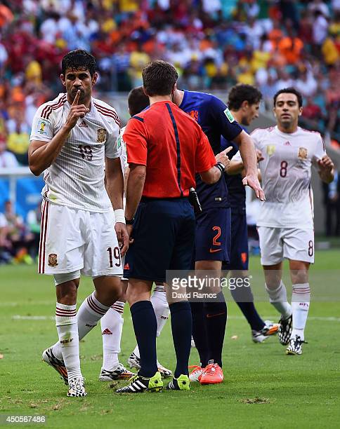 Diego Costa of Spain reacts after as referee Nicola Rizzola speaks to Ron Vlaar of the Netherlands during the 2014 FIFA World Cup Brazil Group B...