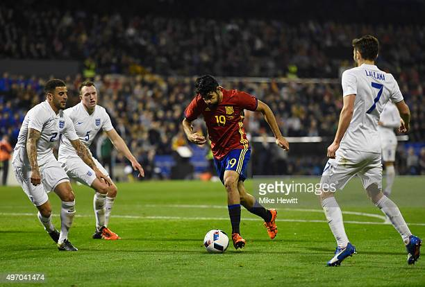 Diego Costa of Spain takes on Kyle Walker Phil Jones and Adam Lallana of England during the international friendly match between Spain and England at...