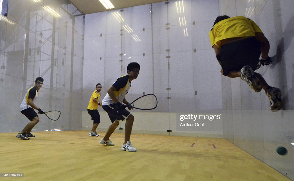 Diego Crespo and Ernesto Ruiz of Boilivia, and Jose Alvarez and Fernando Mun–oz of Ecuador compete in racquetball as part of the XVII Bolivarian Games Trujillo 2013 at Villa Deportiva Regional del Callao on November 23, 2013 in Lima, Peru.