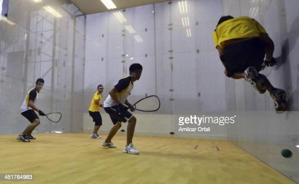 Diego Crespo and Ernesto Ruiz of Boilivia and Jose Alvarez and Fernando Mun–oz of Ecuador compete in racquetball as part of the XVII Bolivarian Games...