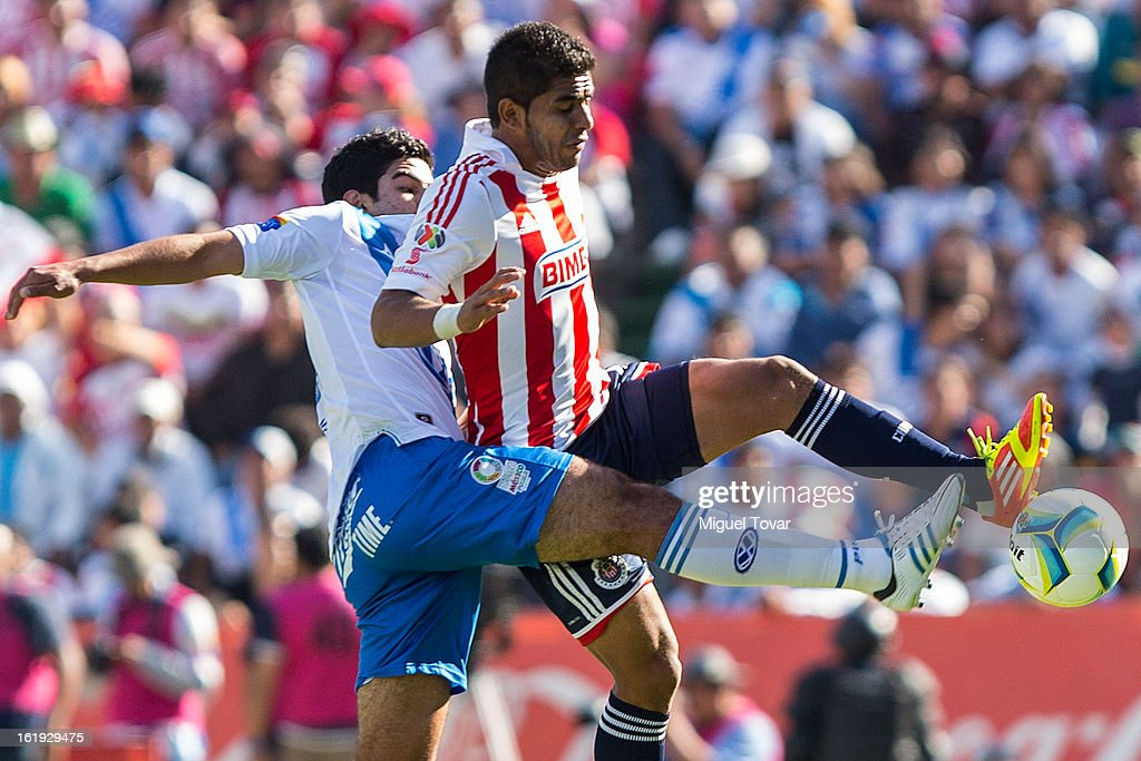 Diego de Buen of Puebla fights for the ball with Miguel Ponce of Chivas during a match between Puebla and Chivas as part of the Clausura 2013 at Cuauhtemoc Stadium on February 17, 2013 in Puebla, Mexico.