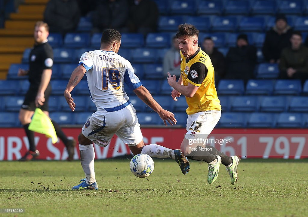 Diego De Girolamo of Northampton Town attempts move past the challenge of Tom Soares of Bury during the Sky Bet League Two match between Bury and...