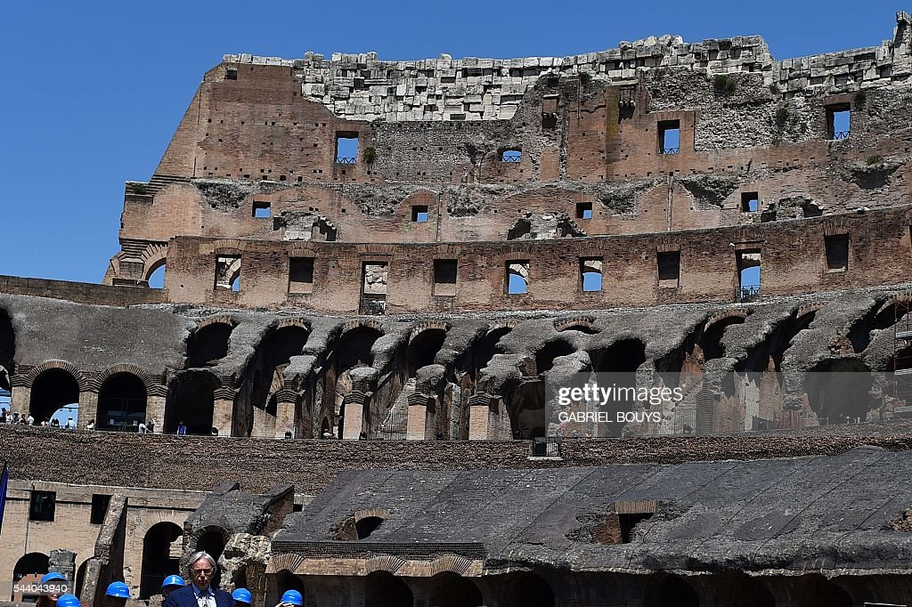 Diego della Valle, CEO of luxury shoe brand Tod's, speaks during a press conference on July 1, 2016 to announce the end of the restoration of the façade of the Colosseum that his company funded. / AFP / GABRIEL