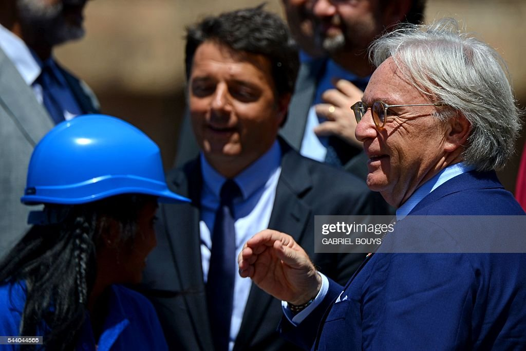 Diego della Valle, CEO of luxury shoe brand Tod's (R), speaks next to Italian Prime Minister Matteo Renzi (C) during a press conference on July 1, 2016 in Rome to announce the end of the restoration of the façade of the Colosseum financed by top luxury brands. / AFP / GABRIEL