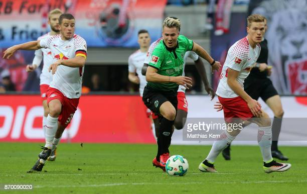 Diego Demme Felix Klaus and Marcel Halstenberg battle for the ball during the Bundesliga match between RB Leipzig and Hannover 96 at Red Bull Arena...