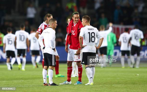 Diego Demme of Germany Yussuf Yurary Poulsen of Denmark and Joshua Kimmich of Germany talk after the international friendly match between Denmark v...