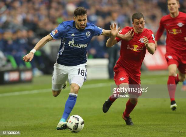Diego Demme of Leipzig and Daniel Caligiuri of Schalke battle for the ball during the Bundesliga match between FC Schalke 04 and RB Leipzig at...
