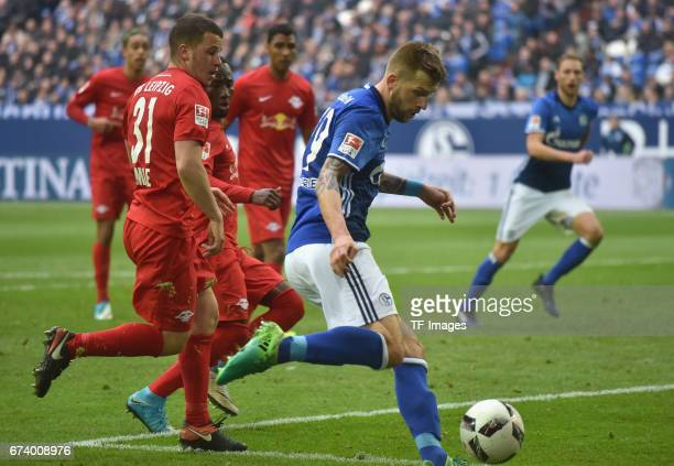 Diego Demme of Leipzig and Guido Burgstaller of Schalke battle for the ball during the Bundesliga match between FC Schalke 04 and RB Leipzig at...
