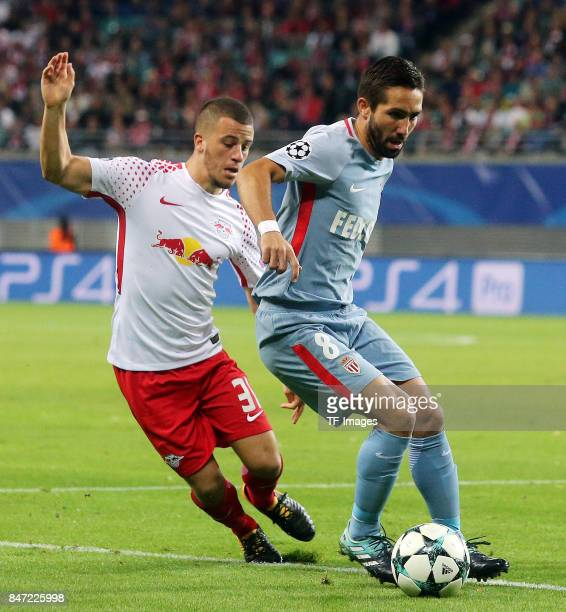 Diego Demme of Leipzig and Joao Moutinho of Monaco battle for the ball during the UEFA Champions League group G match between RB Leipzig and AS...