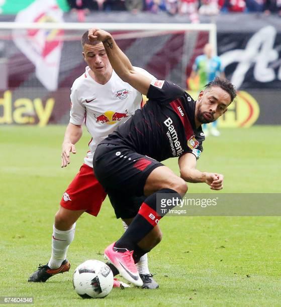 Diego Demme of Leipzig and Karim Bellarabi of Leverkusen battle for the ball during the Bundesliga match between RB Leipzig and Bayer 04 Leverkusen...