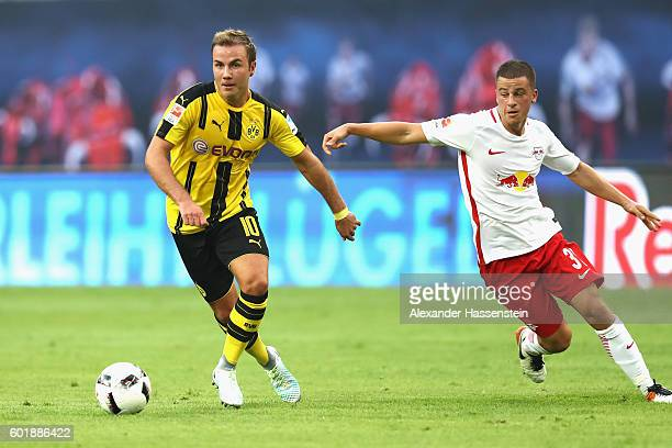 Diego Demme of Leipzig battles for the ball with Mario Goetze of Dortmund during the Bundesliga match between RB Leipzig and Borussia Dortmund at Red...
