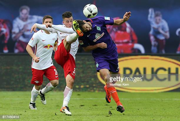 Diego Demme of Leipzig battles for the ball with Santiago Garcia of Bremen during the Bundesliga match between RB Leipzig and SV Werder Bremen at Red...