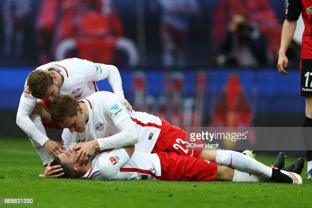 Diego Demme of Leipzig celebrates after scoring their first goal with his teammate Marcel Halstenberg during the Bundesliga match between RB Leipzig...