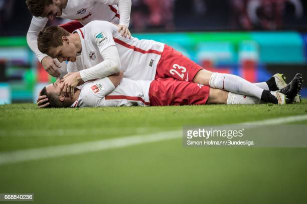 Diego Demme of Leipzig celebrates his team's fourth goal with team mate Marcel Halstenberg during the Bundesliga match between RB Leipzig and SC...