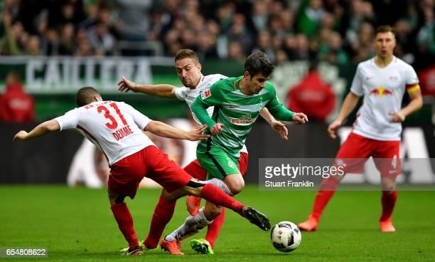 Diego Demme of Leipzig challenges Fin Bartels of Bremen during the Bundesliga match between Werder Bremen and RB Leipzig at Weserstadion on March 18...