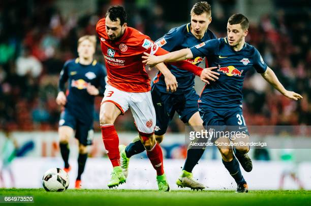 Diego Demme of Leipzig challenges Levin Oeztunali of Mainz 05 during the Bundesliga match between 1 FSV Mainz 05 and RB Leipzig at Opel Arena on...