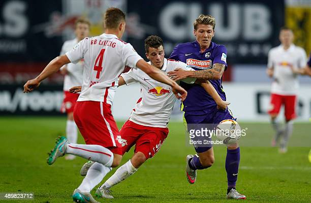Diego Demme of Leipzig challenges Mike Frantz of Freiburg during the Second Bundesliga match between RB Leipzig and SC Freiburg at Red Bull Arena on...