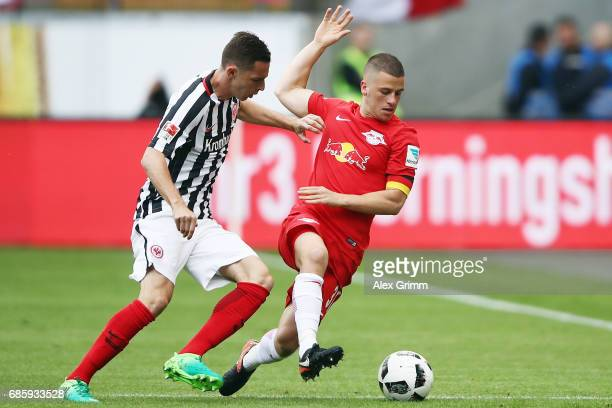 Diego Demme of Leipzig is challenged by Branimir Hrgota of Frankfurt during the Bundesliga match between Eintracht Frankfurt and RB Leipzig at...