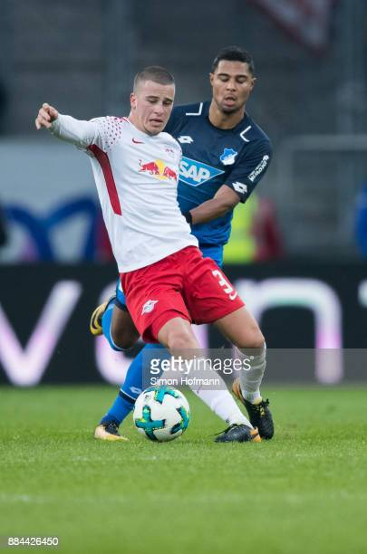 Diego Demme of Leipzig is challenged by Serge Gnabry of Hoffenheim during the Bundesliga match between TSG 1899 Hoffenheim and RB Leipzig at Wirsol...