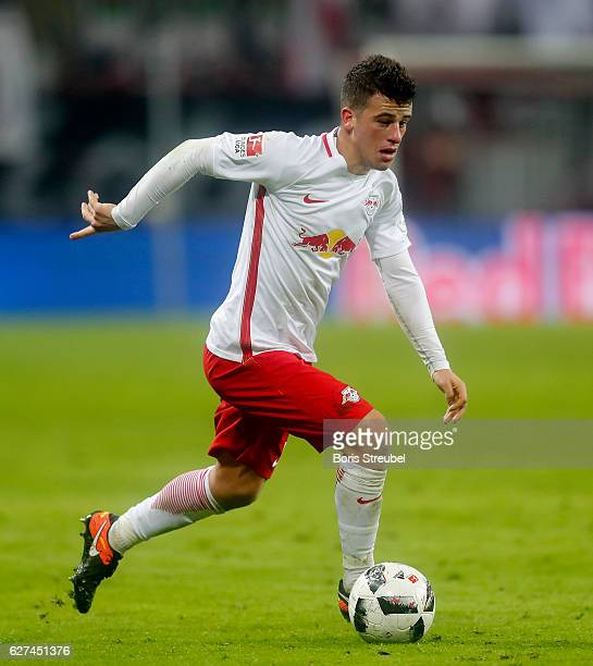 Diego Demme of RB Leipzig runs with the ball during the Bundesliga match between RB Leipzig and FC Schalke 04 at Red Bull Arena on December 3 2016 in...