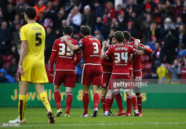 Diego Fabbrini of Middlesbrough celebrates the opening goal with team mates during the Emirates FA Cup third round match between Middlesbrough and...