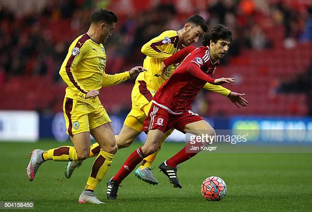 Diego Fabbrini of Middlesbrough holds off Michael Kightly and David Jones of Burnley during the Emirates FA Cup third round match between...