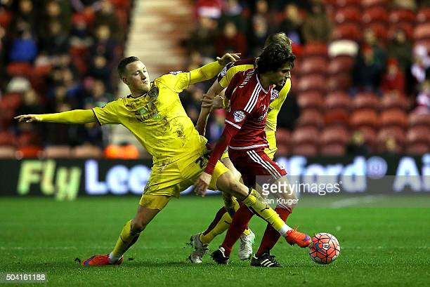 Diego Fabbrini of Middlesbrough is challenged by Fredrik Ulvestad of Burnley during the Emirates FA Cup third round match between Middlesbrough and...
