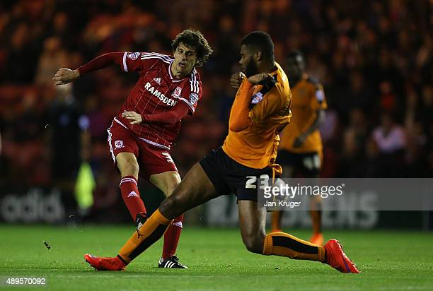 Diego Fabbrini of Middlesbrough shoots at goal under pressure from Ethan EbanksLandell of Wolverhampton Wanderers during the Capital One Cup third...
