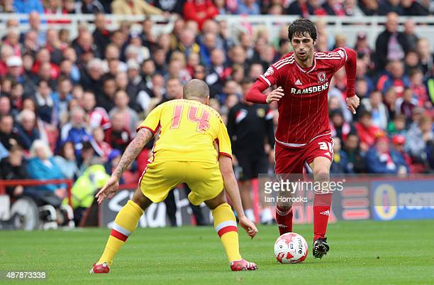 Diego Fabbrini of Middlesbrough takes onSamir Carruthers of Mk Dons during the the Sky Bet Championship match between Middlesbrough and Milton Keynes...