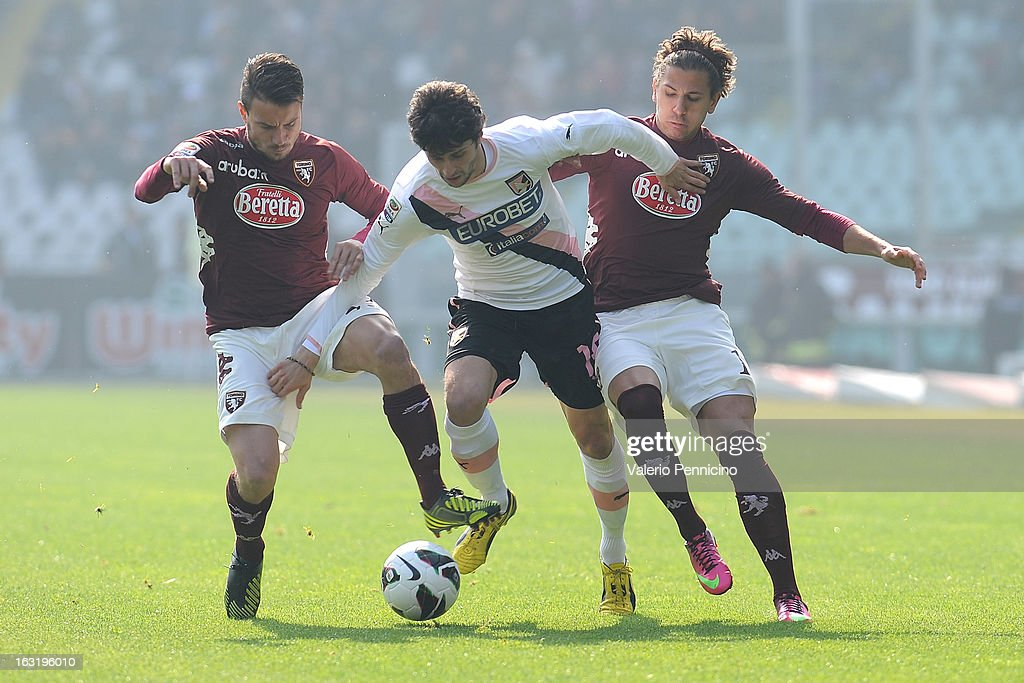 Diego Fabbrini (C) of US Citta di Palermo is challenged by Matteo Brighi (L) and Alessio Cerci of Torino FC during the Serie A match between Torino FC and US Citta di Palermo at Stadio Olimpico di Torino on March 3, 2013 in Turin, Italy.
